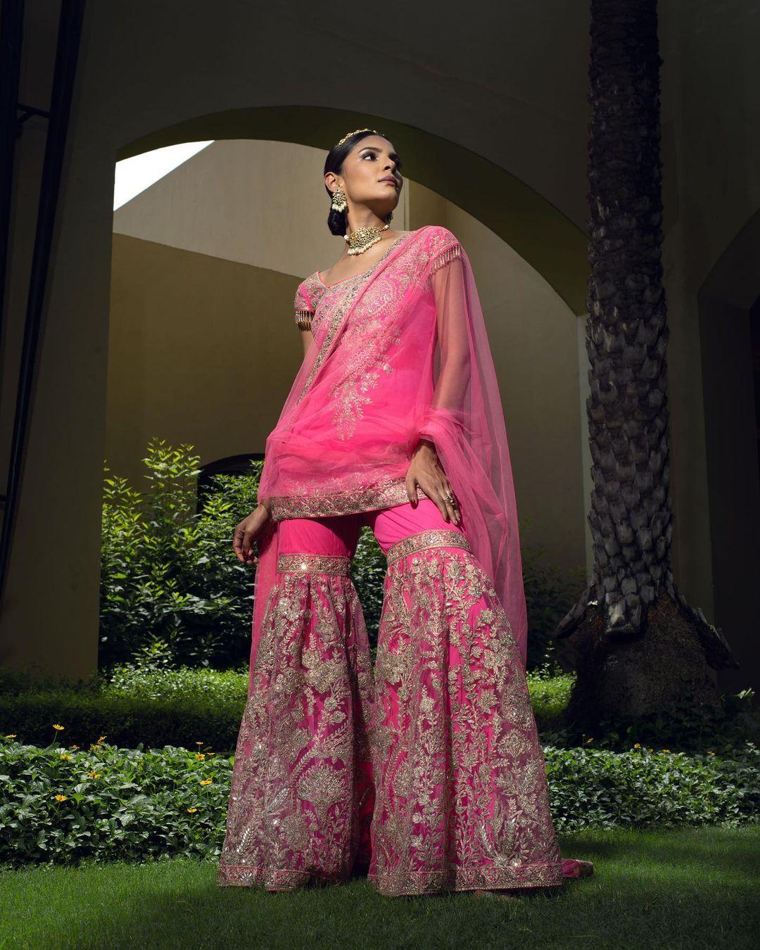Beautiful pink hand embroidery sharara set with short kurti.   2021-09-15