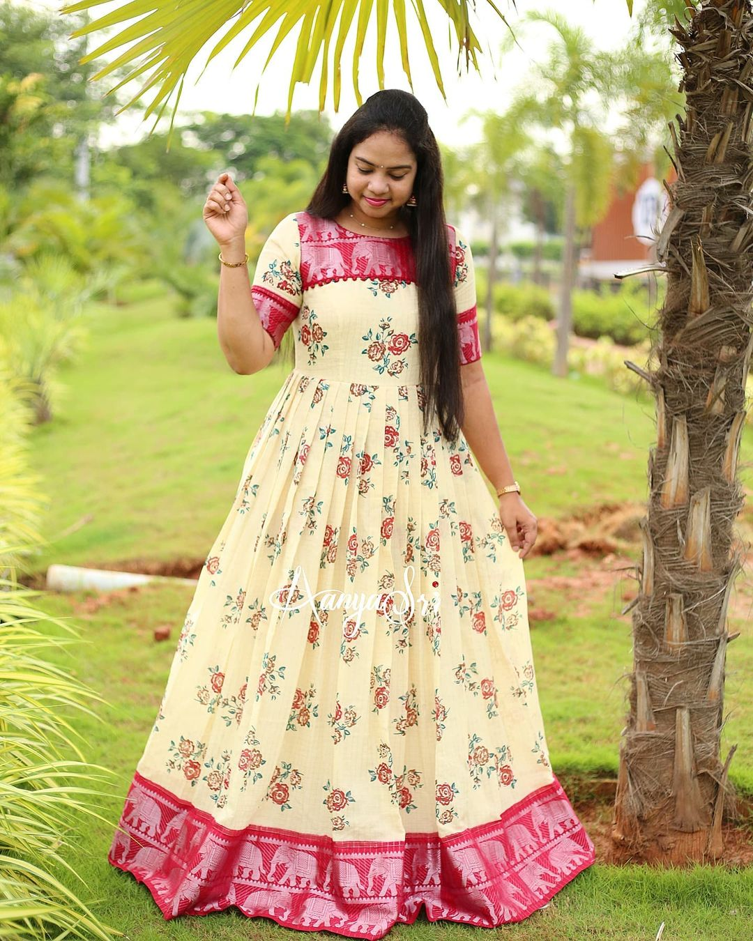 Cream floral maxi with silver zari checks all over and a red elephants silver border. Comes with potlis detailed yoke. Price : RS. 3200/-   Perfect for the upcoming festive season. 2021-09-15