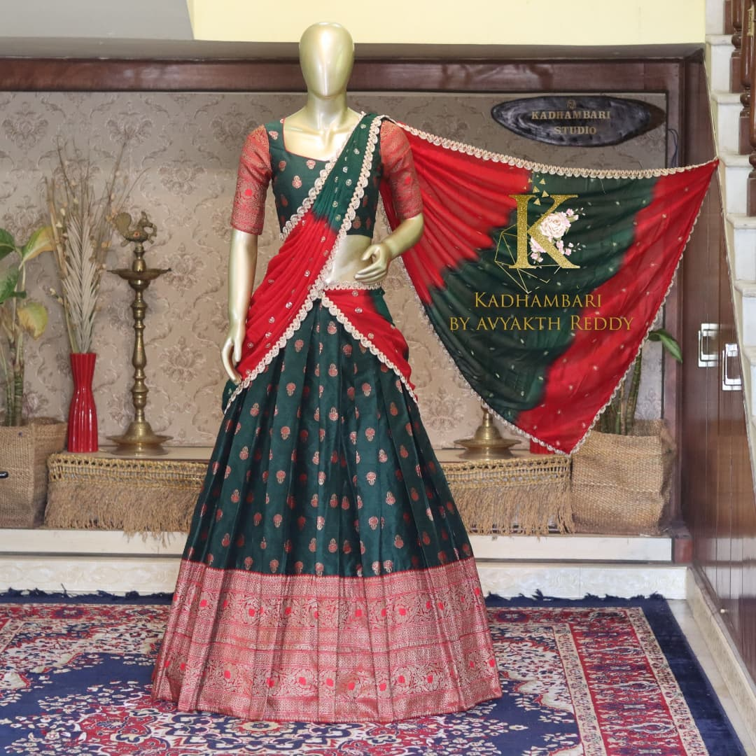 Lovely bottle green color pattu lehenga and blouse dual color dupatta. Blousewith maggam work blouse. This outfit is Available at 11000/- 2021-09-15