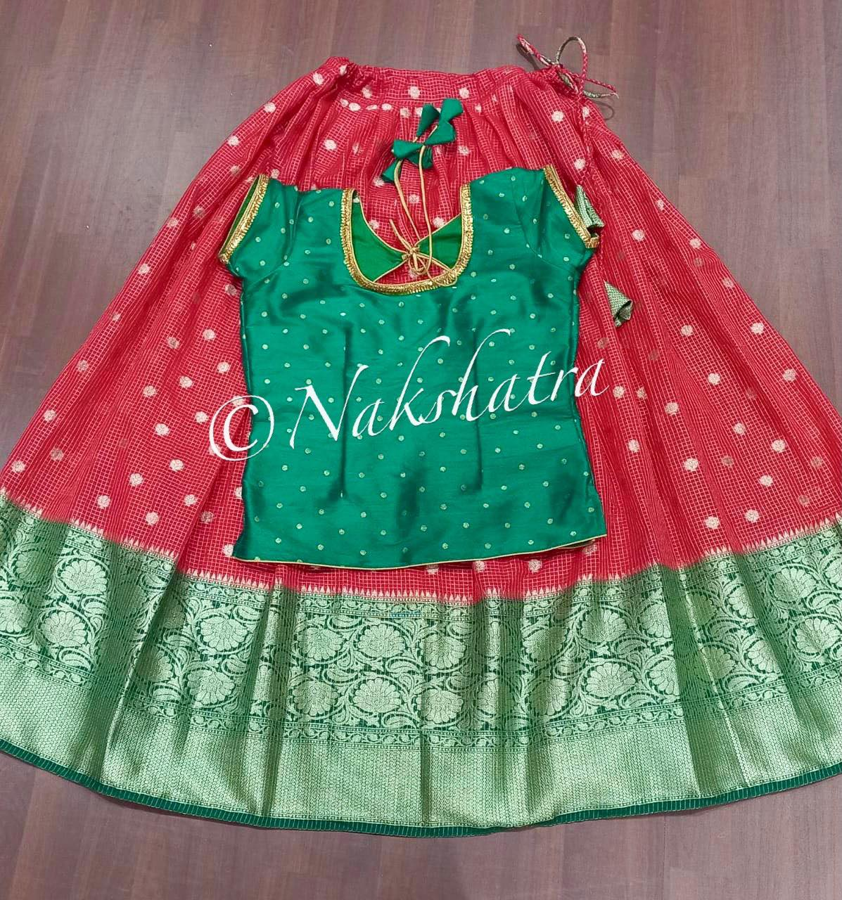Gorgeous red and green color combination kids pattu lehenga and red long blouse. 2021-09-16