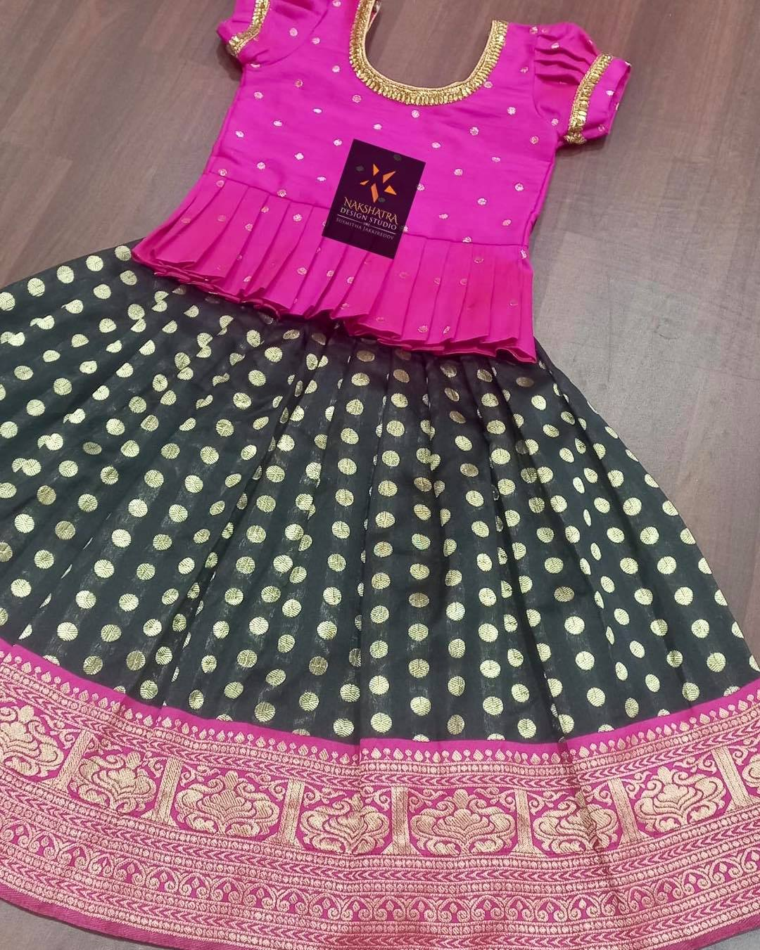 Gorgeous black and pink color combination kids pattu lehenga and pink long blouse. 2021-09-16
