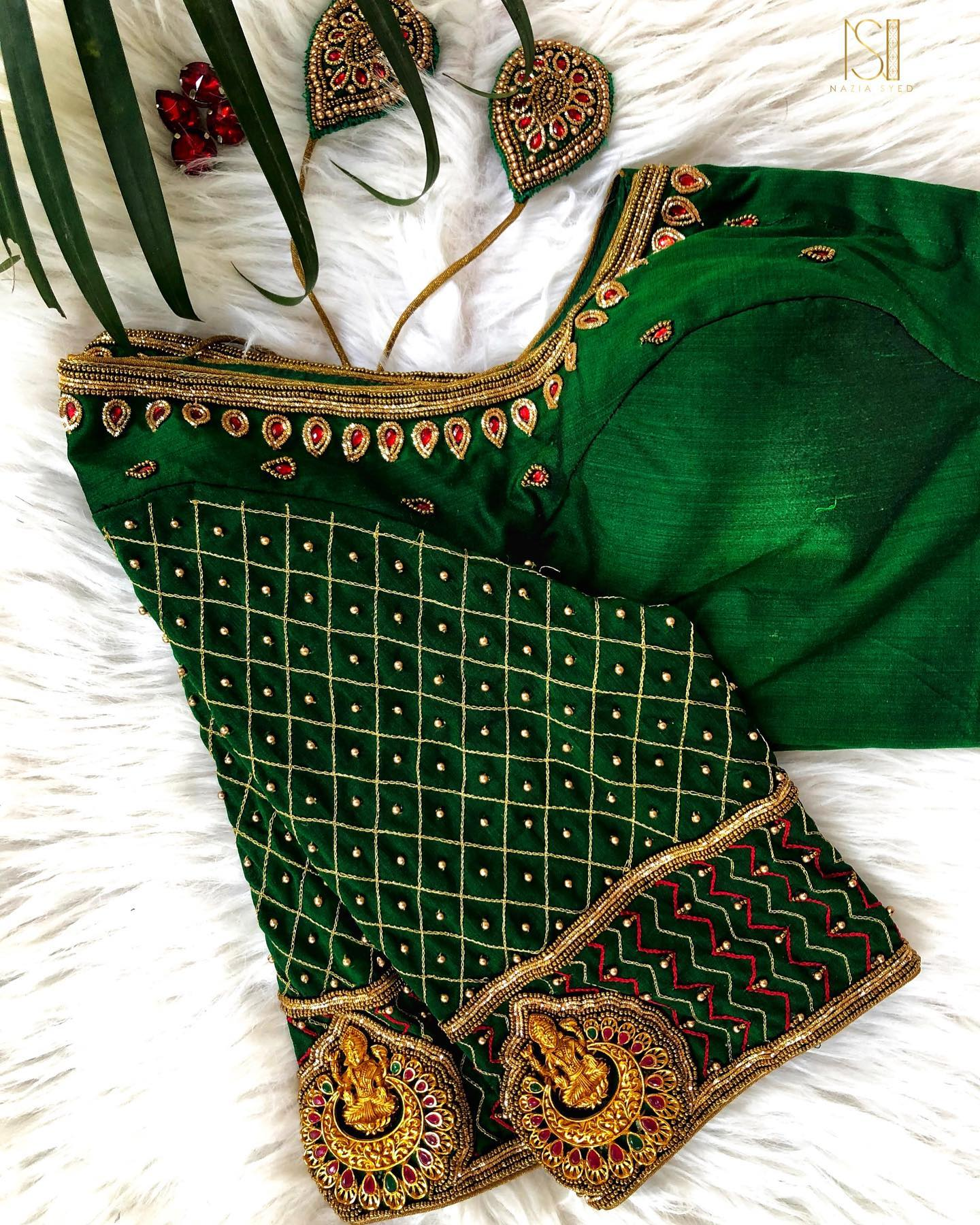 Classic bottle green silk blouse with lakshmi grid work with custom made tassels. Colour customization available .Dm or whatsapp to 7092586311 for more enquiries. 2021-09-16