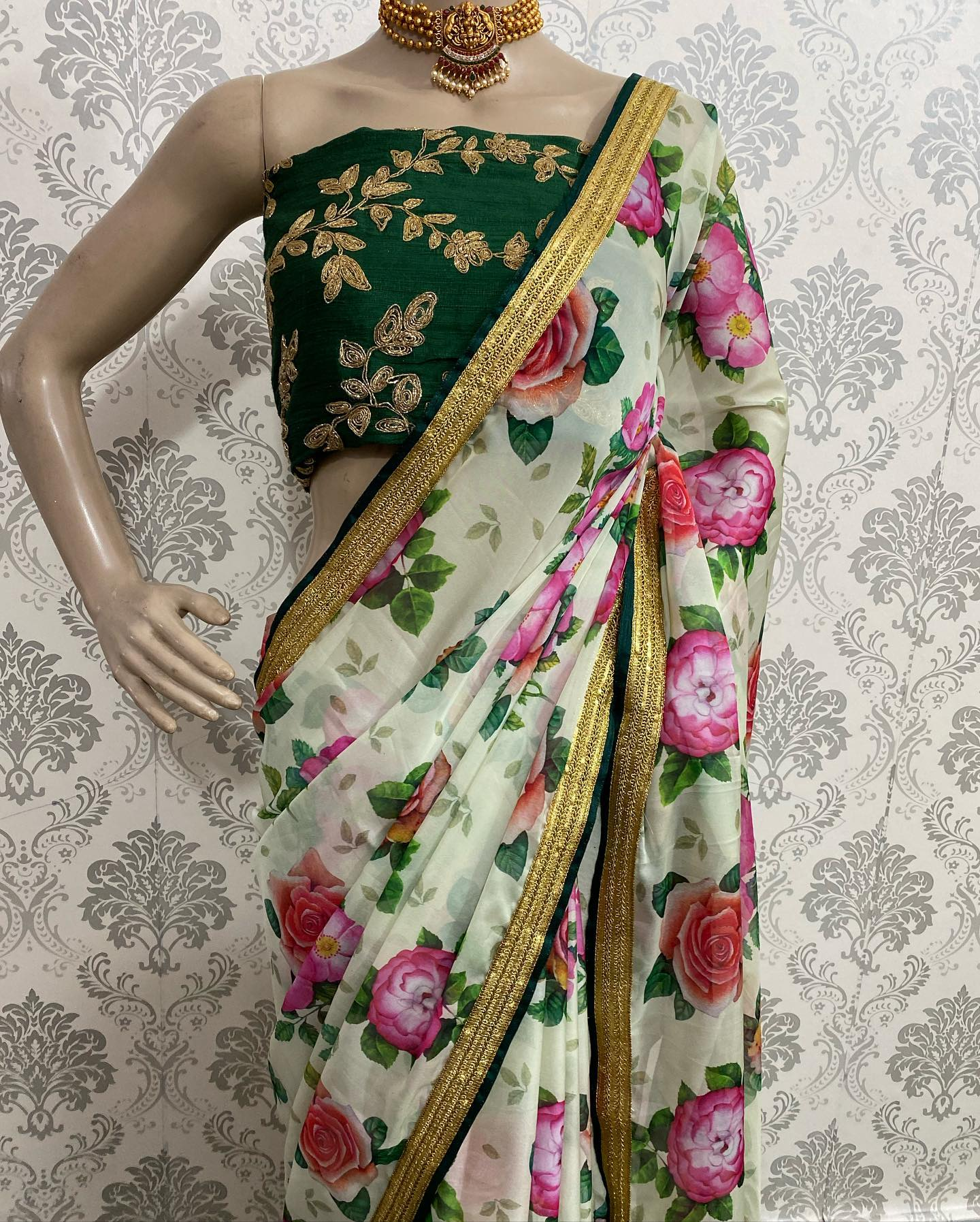Silk green heavy embroidery unstitched blouse with organza floral silk saree and matching Patti and golden rich border.  Watsapp  on 8072774265. 2021-09-16