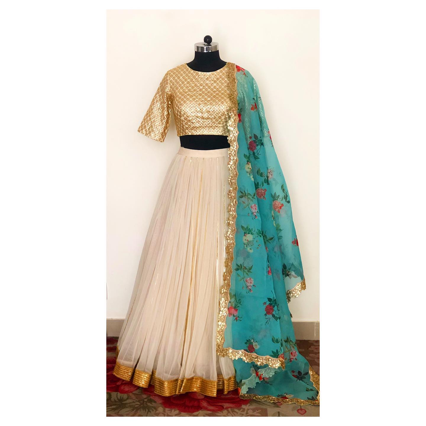 Cream soft net gathered lehenga with kundan embellished blouse and floral print organza dupatta. Can be customised in any color and size. To order/customise DM or WhatsApp at +91-8527463626… 2021-09-16