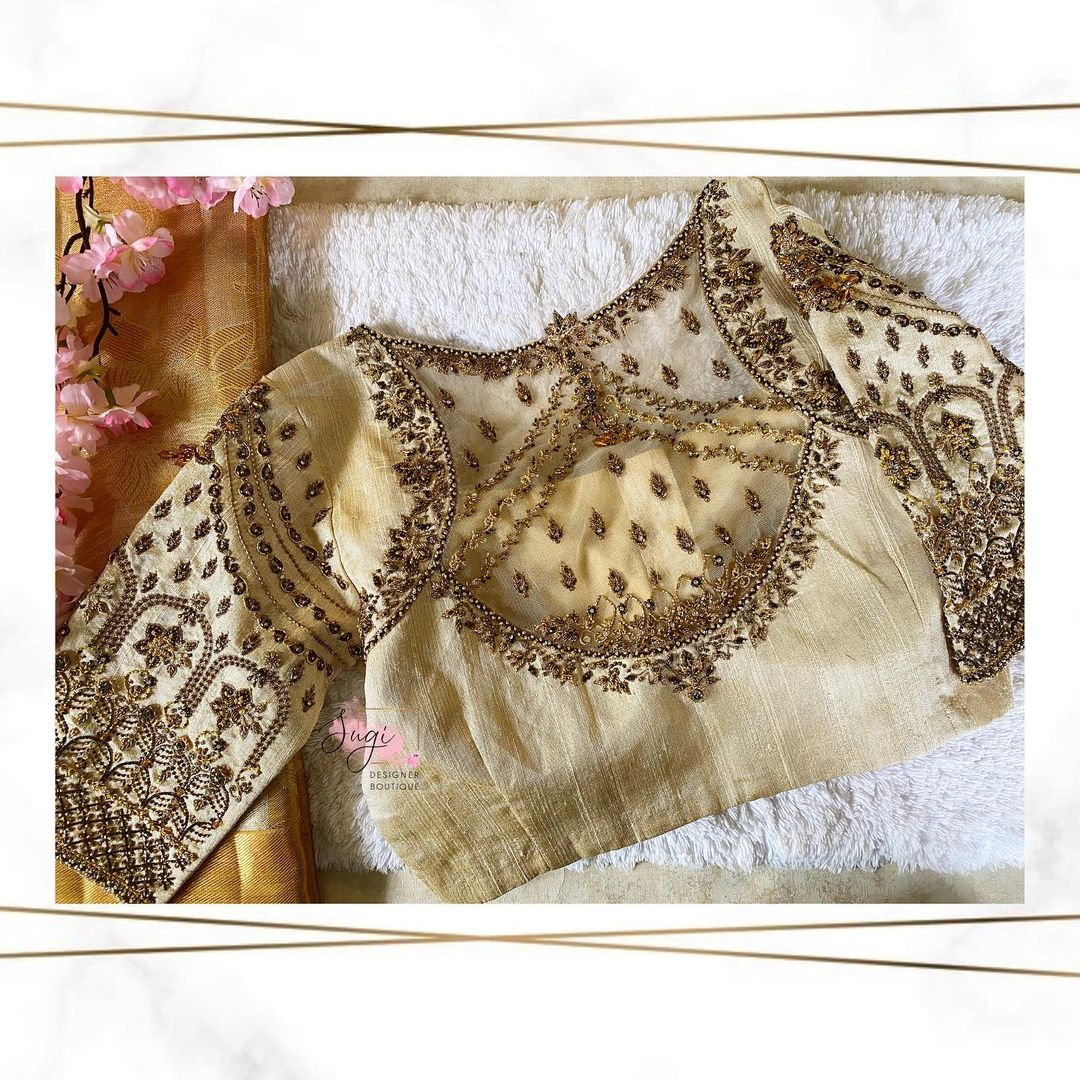 Stunning off white color bridal blouse with sheer back and floral creeper hand embroidery bead aari work.  2021-09-16