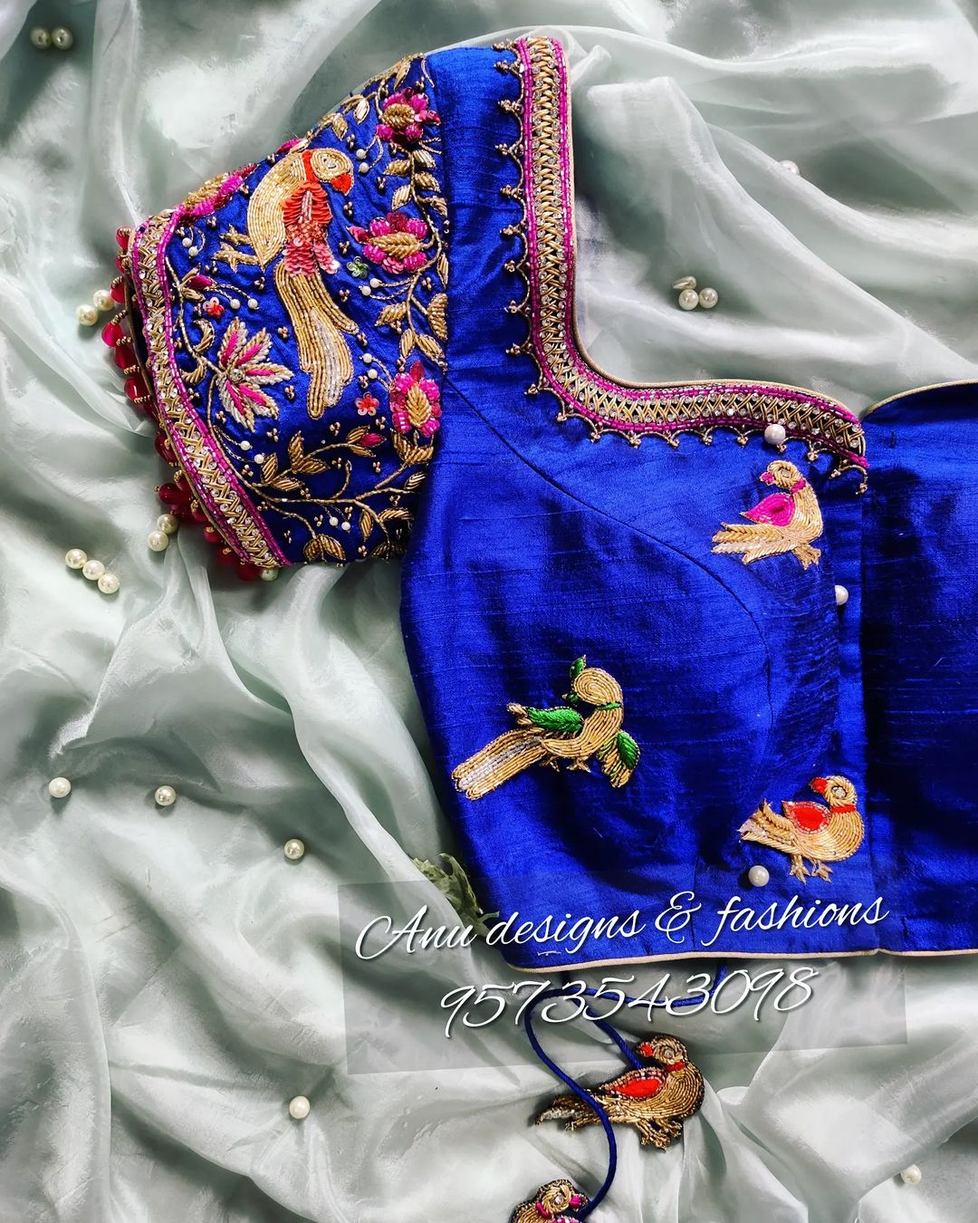Royal blue color bridal blouse with parrot motifs hand embroidery maggam work.  2021-09-16
