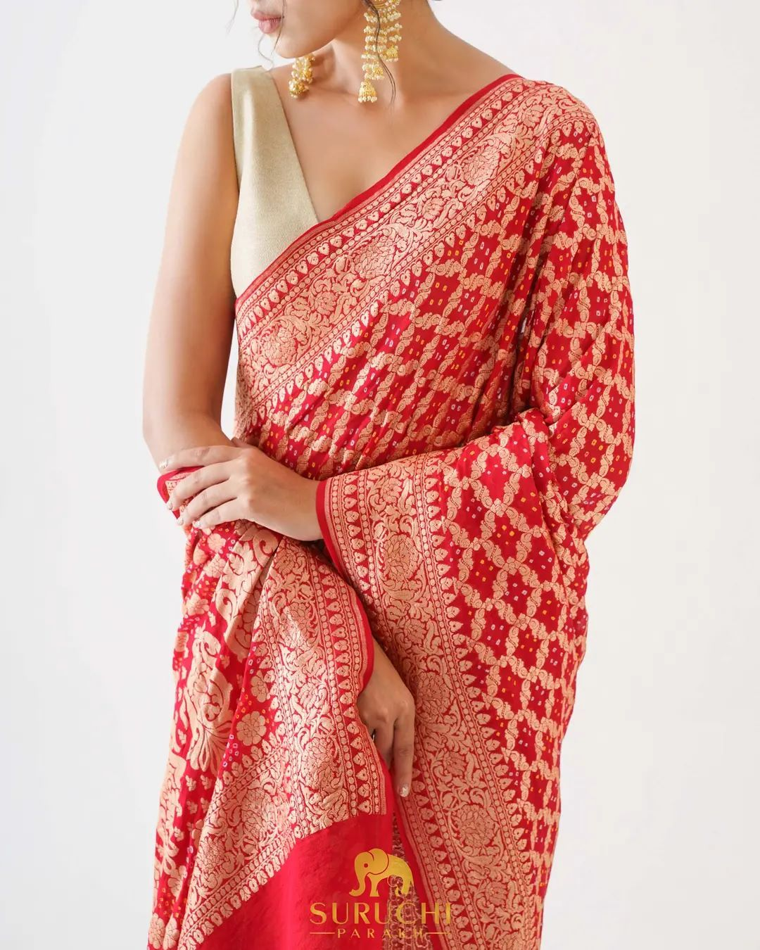 The place of the red saree in ethnic fashion is equal to that of a black dress in western fashion.  A red saree is preferred more among any other color because of its cultural significance and feminine beauty.  This wedding season go completely traditional with a Banarasee Bandhani saree and that too in red! From bride herself to her mother or sister this red saree should definitely make it to your list of outfits for the wedding functions. 2021-09-16