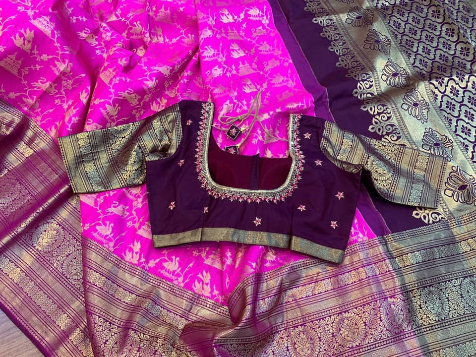 Rani Pink with Brown combination Pure Kanchi Silk with contrast traditional borders with exclusive animal design weave in body  complemented with contrast saree blouse Hand worked blouse. 2021-09-17