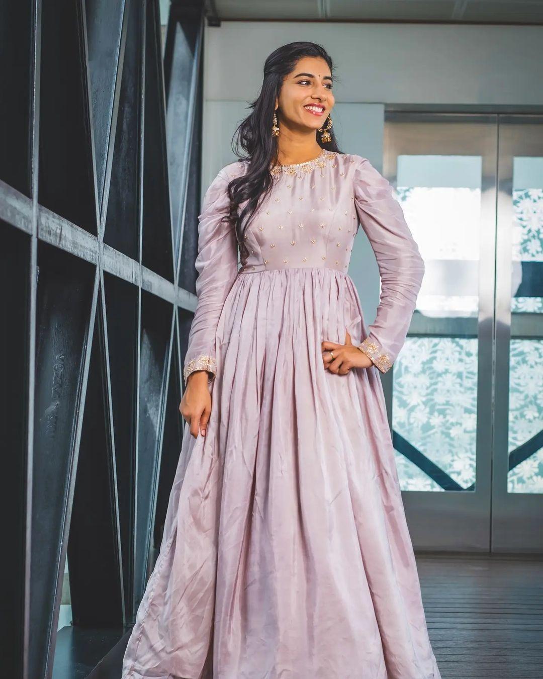 Beautiful actress Vishnu Priya in lavender floor length dress. Styling : Greeshm krishna.k Label : Rv designer studio by rupa.  2021-09-17