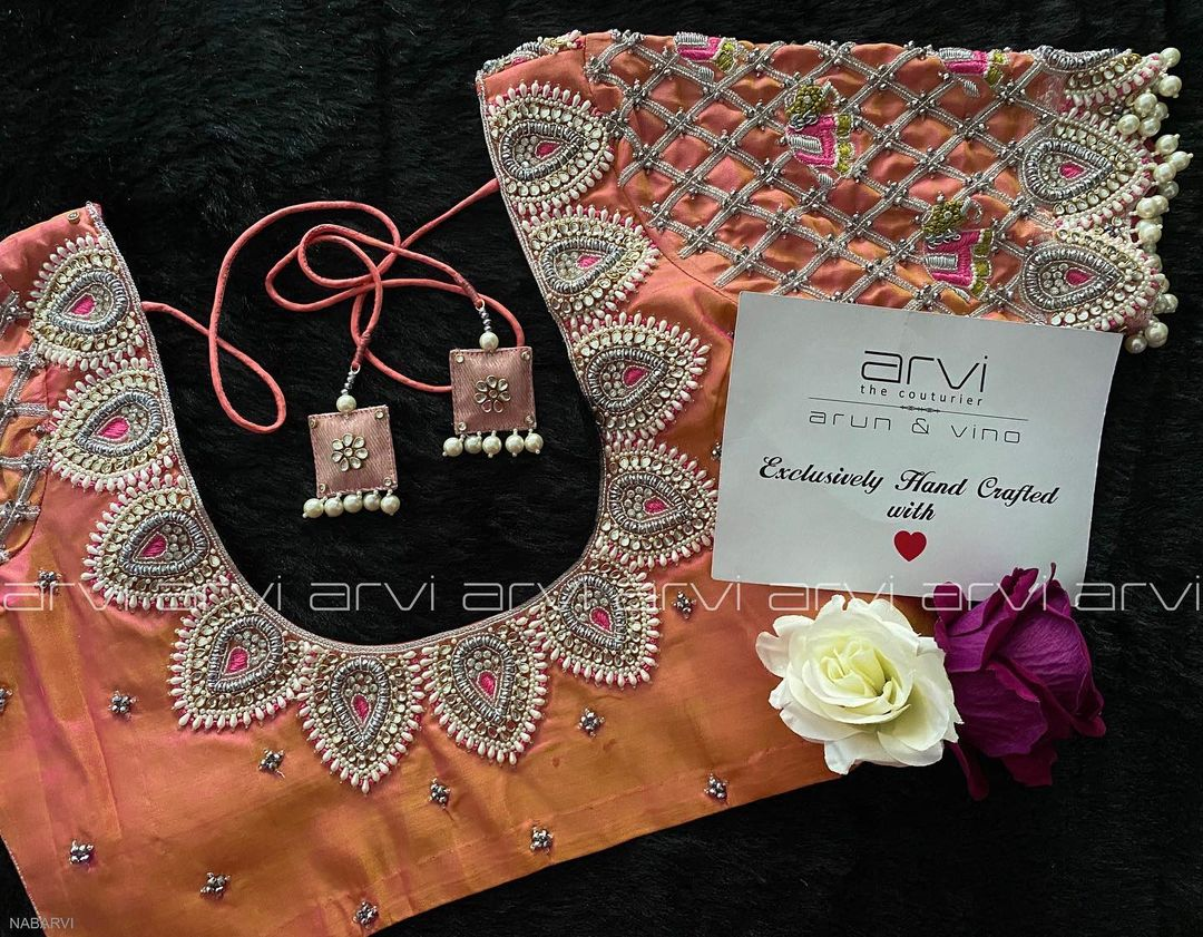 Stunning peach bridal blouse with silver thread and bead maggam work. 2021-09-17