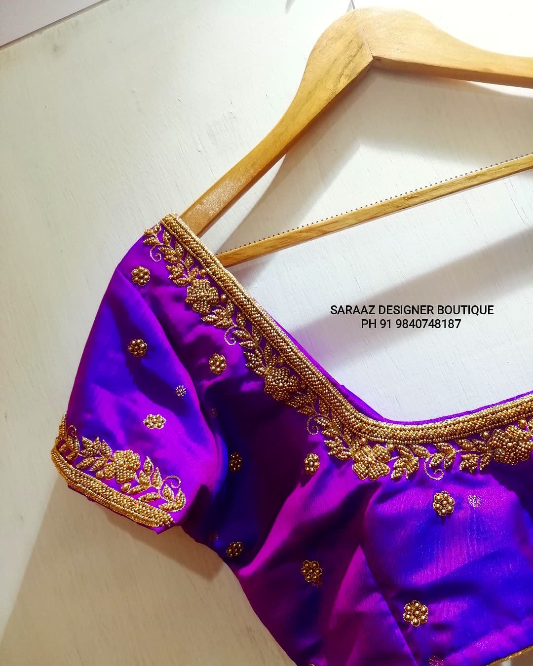 Gorgeous purple color blouse with simple and elegant aari work on neckline and sleeves. 2021-09-17