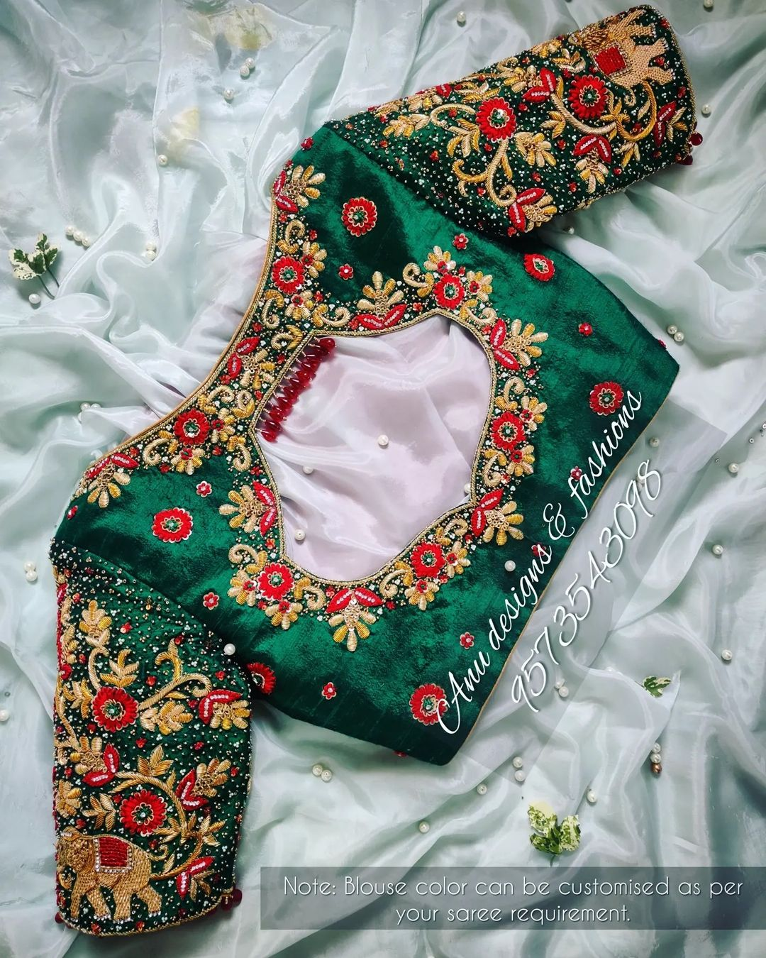 Gorgeous bottle green color bridal blouse with elephant and floral hand embroidery thread maggam work.  2021-09-17