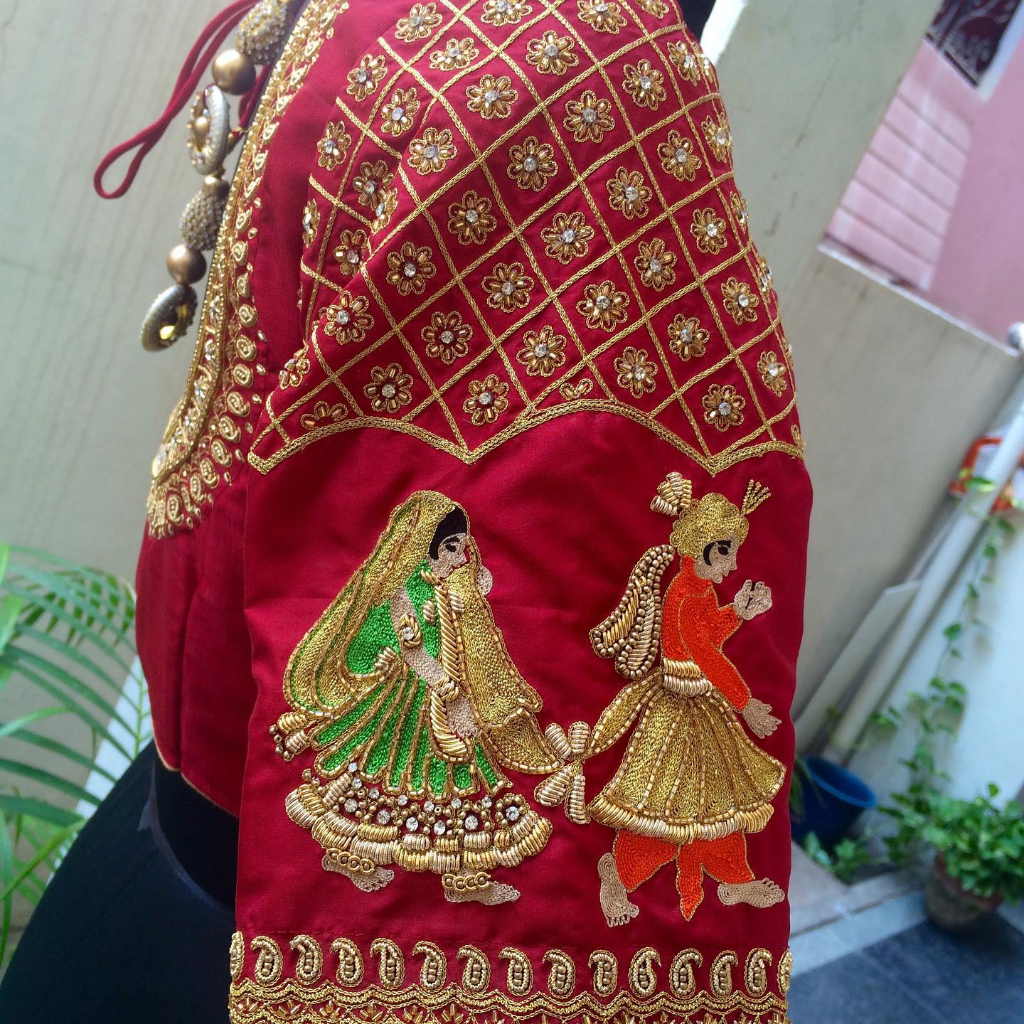 Gorgeous red color bridal blouse sleeve with bride and groom hand embroidery maggam work.  2021-09-18