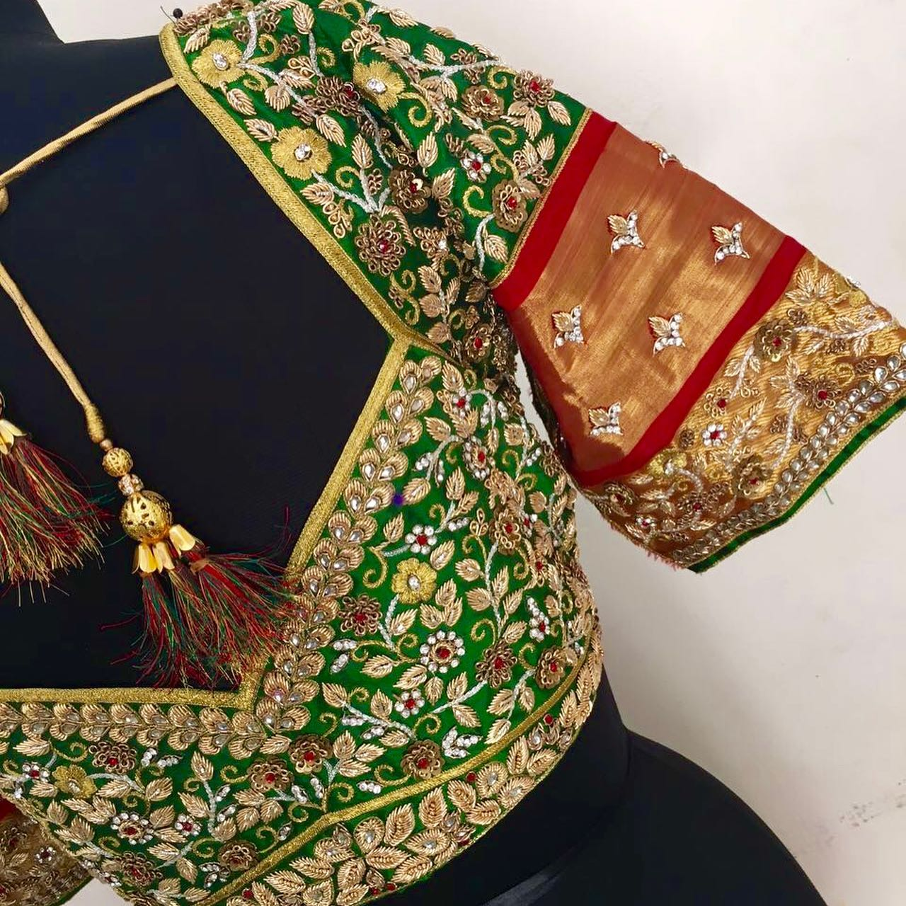 Gorgeous parrot green color bridal blouse with gold thread and stone maggam work.  2021-09-18