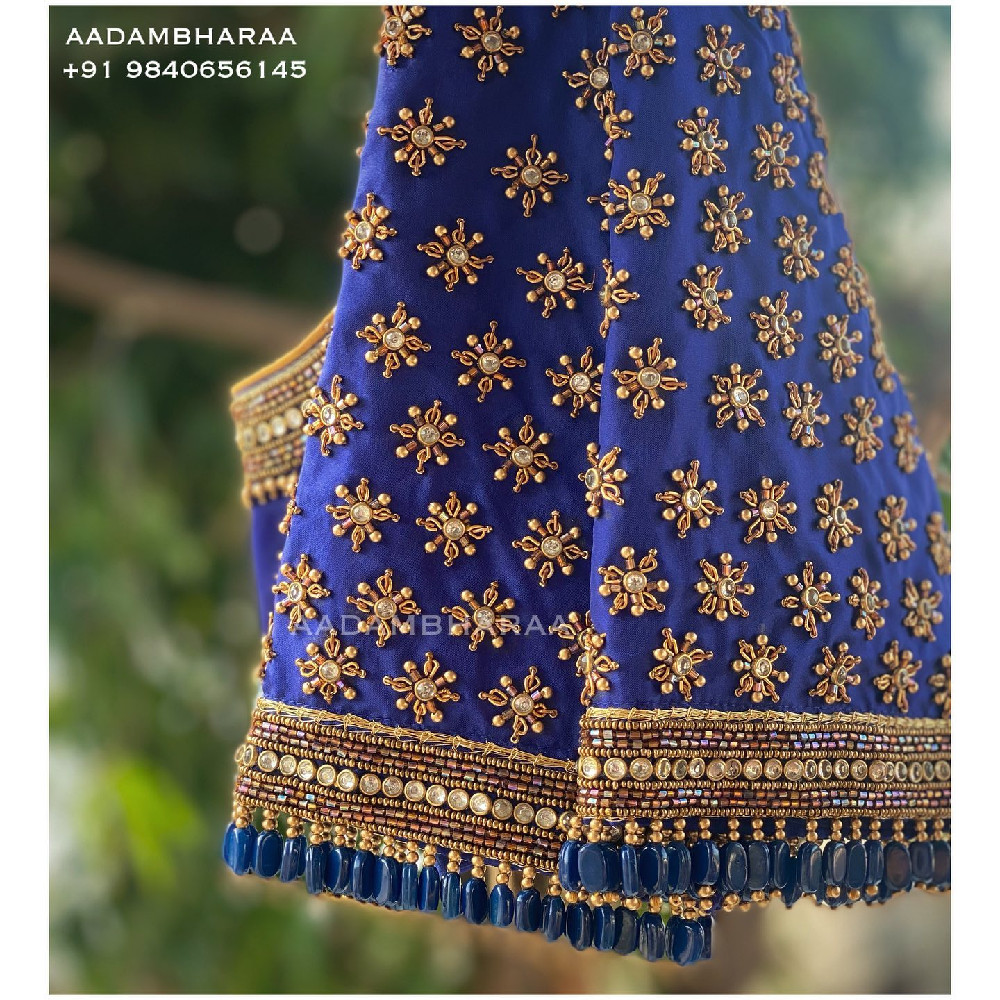 Stunning blue color bridal blouse sleeve with bead and stone aari work. Blue Bridal Blouse. 2021-09-18