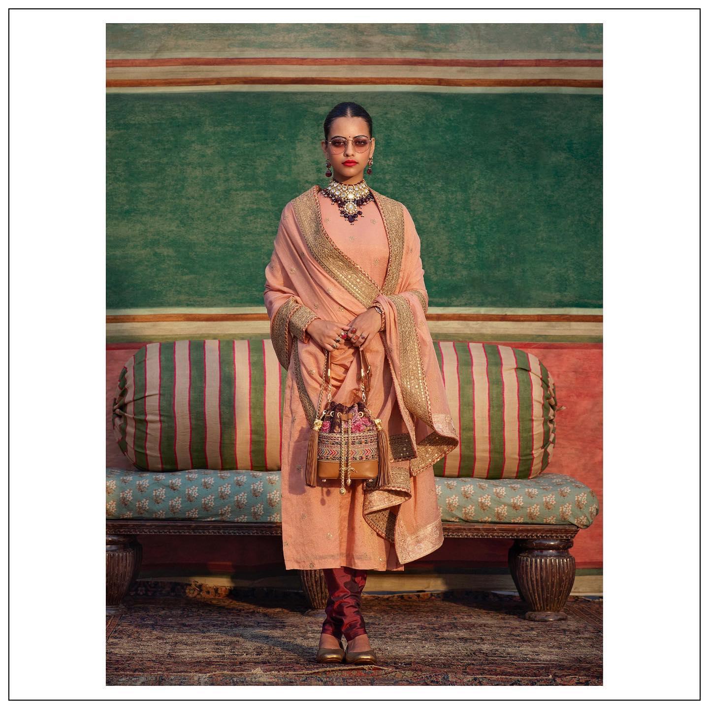 Stunning peach long kurti with hand embroidery work.  2021-09-18