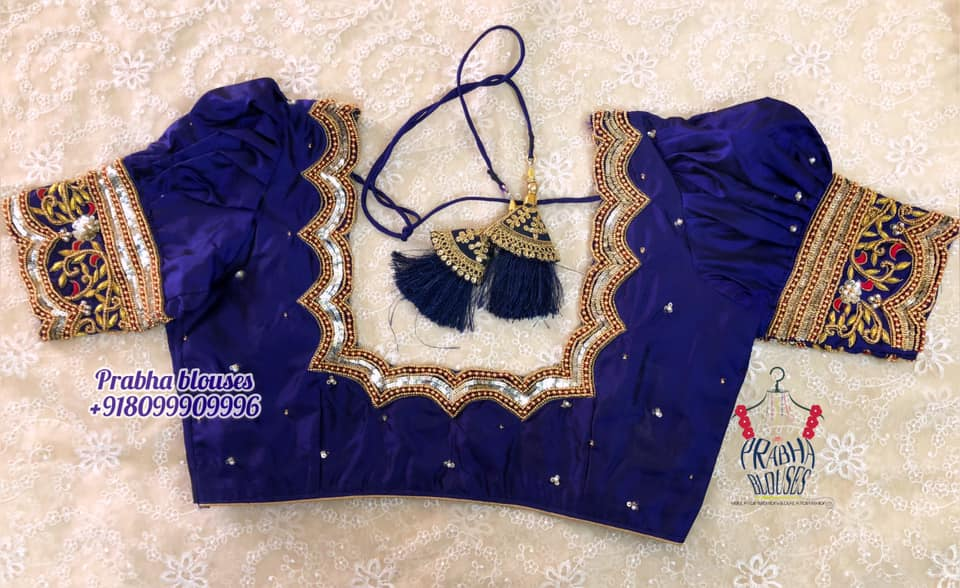Gorgeous blue color puff sleeve blouse with bead and stone maggam work. 2021-09-18