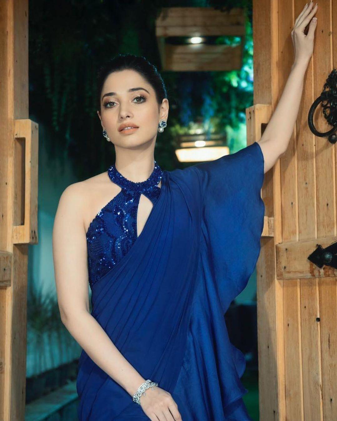 Stunning actress Tammanna Bhatia in blue ruffle saree with halter neck blouse. 2021-09-18