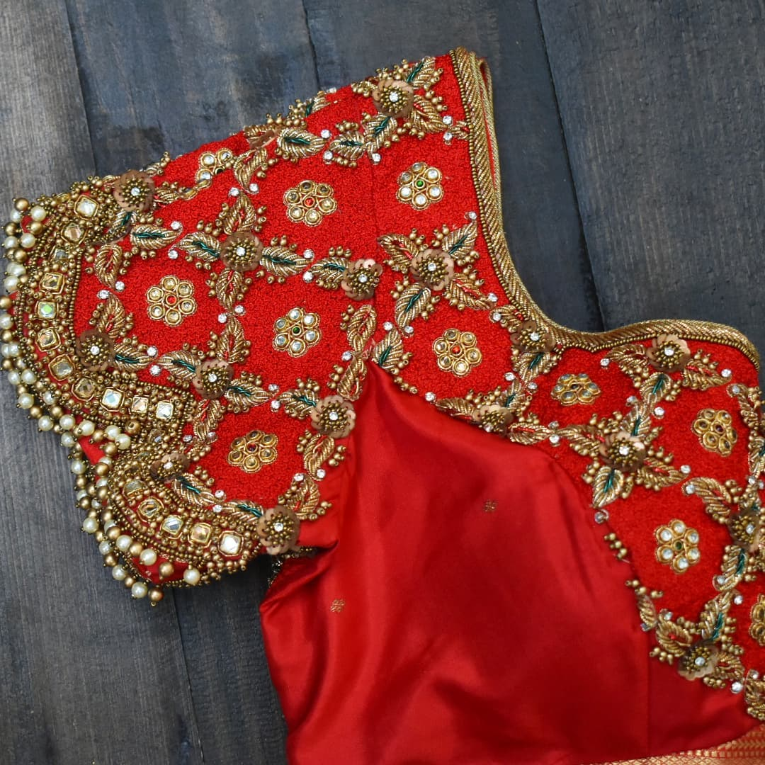 Stunning red color bridal blouse with hand embroidery zardosi work.  recent twist with arrika checks! 2021-09-18