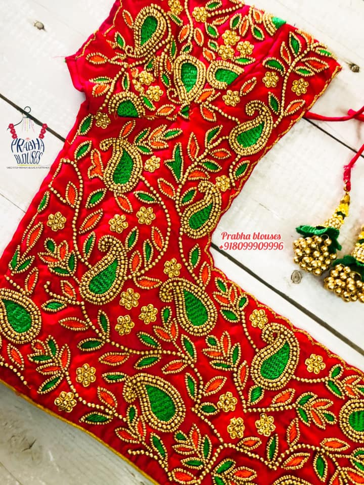 Stunning red color bridal blouse with mango and creeper hand embroidery bead aari work.  2021-09-19