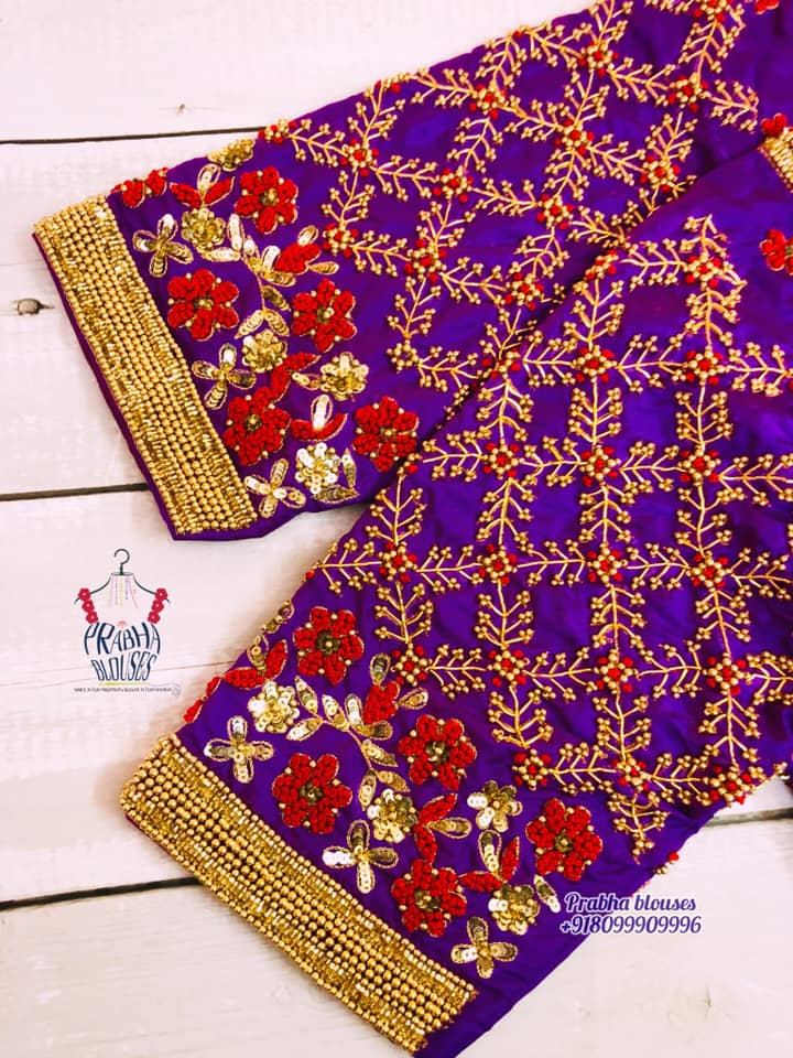 Gorgeous purple color bridal blouse with floral and creeper hand embroidery thread and bead maggam work.  2021-09-19