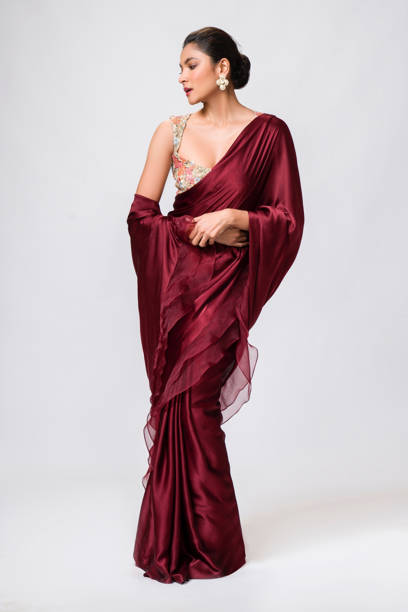 A whimsical wine hued satin sari hemmed with ruffled organza.  Kindly WhatsApp  on +91-9833520520 for more information. 2021-09-19