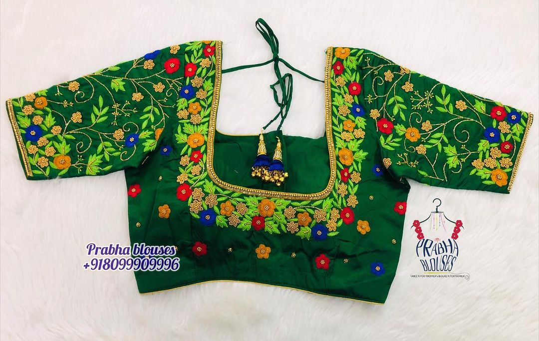 Gorgeous green color bridal blouse with flora and creeper hand embroidery thread maggam work. 2021-09-19