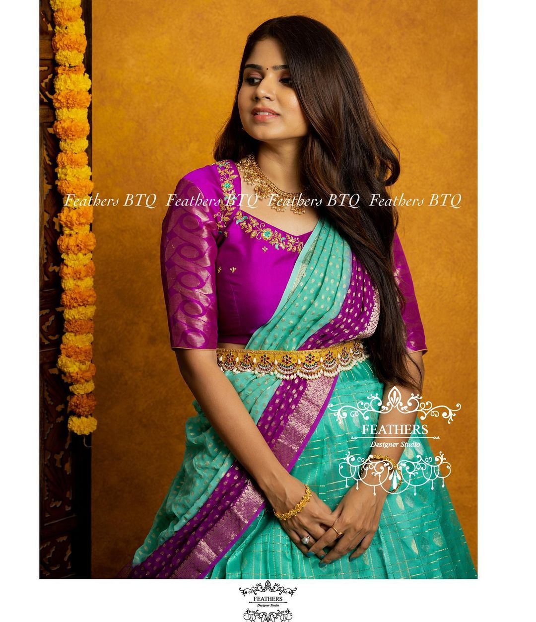 Stunning powder blue and purple color combination pattu langa voni and blouse with hand embroidery work.  2021-09-19