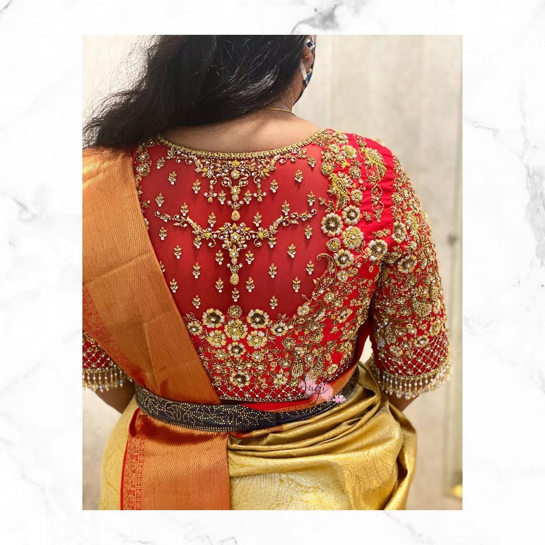 Stunning red color bridal blouse with floral hand embroidery gold thread and bead maggam work.  2021-09-19