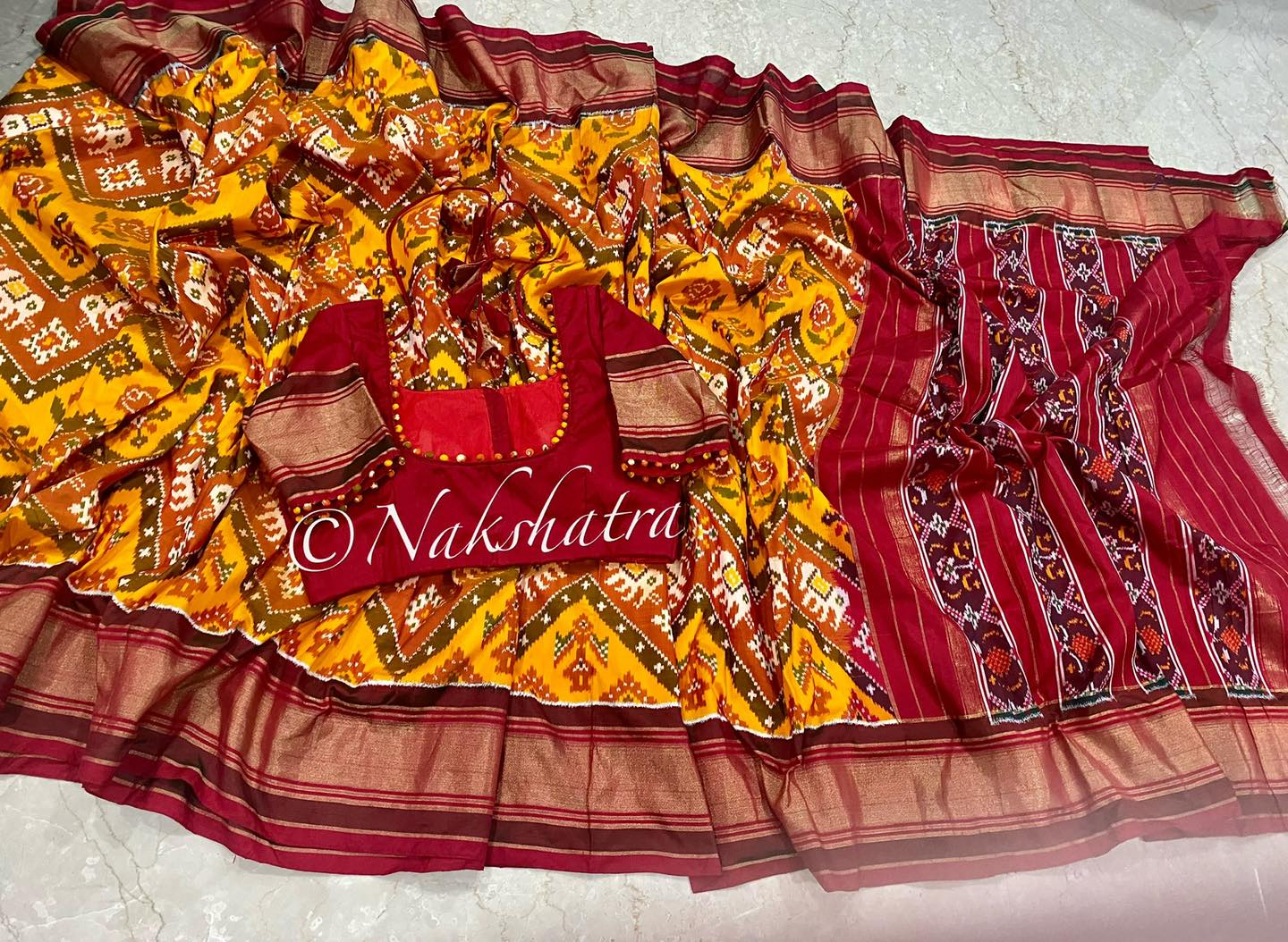 Stunning yellow and maroon color combination ikkath saree. 2021-09-20