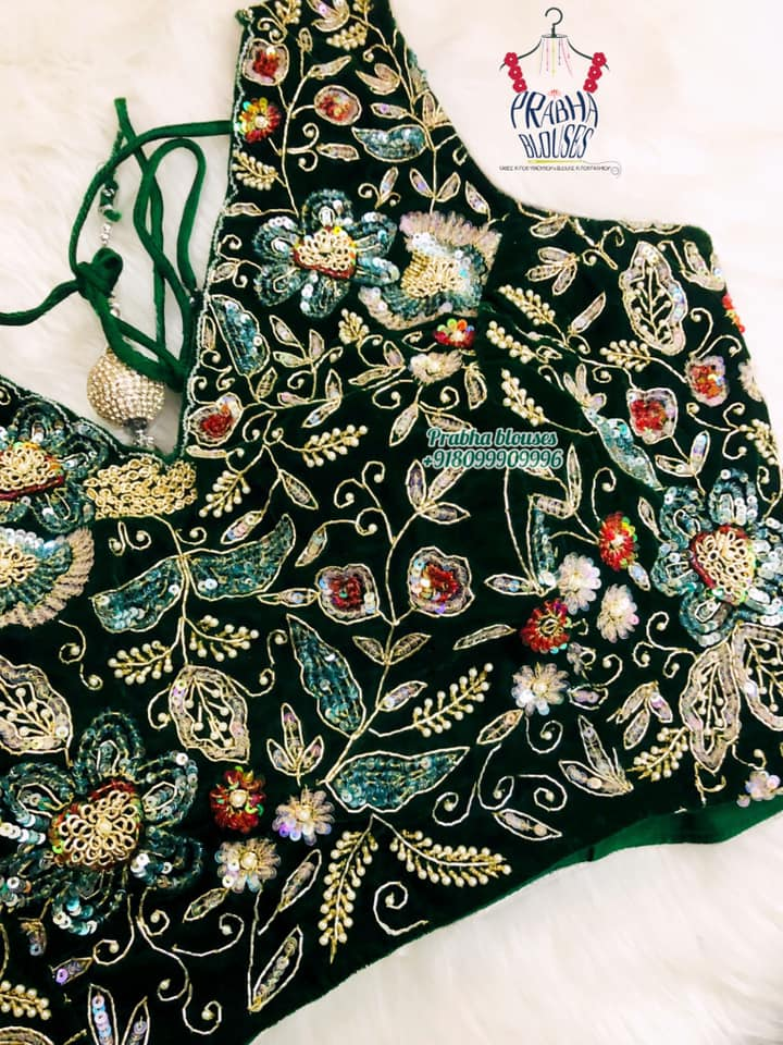 Stunning bottle green sleeveless blouse with floral maggam work. 2021-09-20