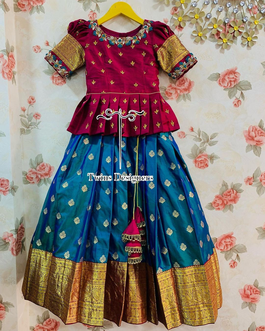 Gorgeous powder blue color kids pattu lehenga and maroon color long blouse with hand embroidery work neckline and sleeves..  2021-09-20