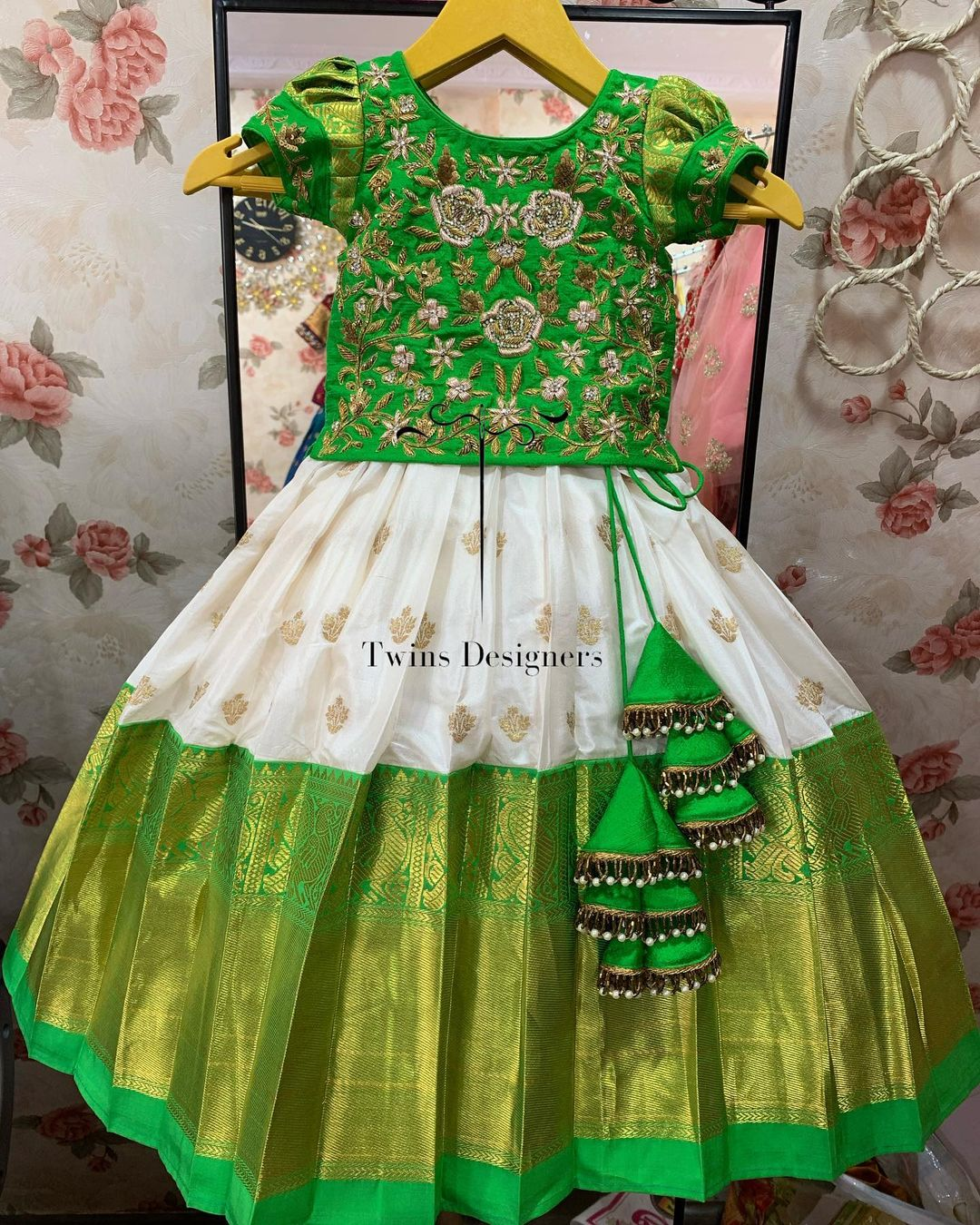 Gorgeous white and green  color combo kids pattu lehenga and grenn long blouse with hand embroidery work neckline and sleeves..  2021-09-20