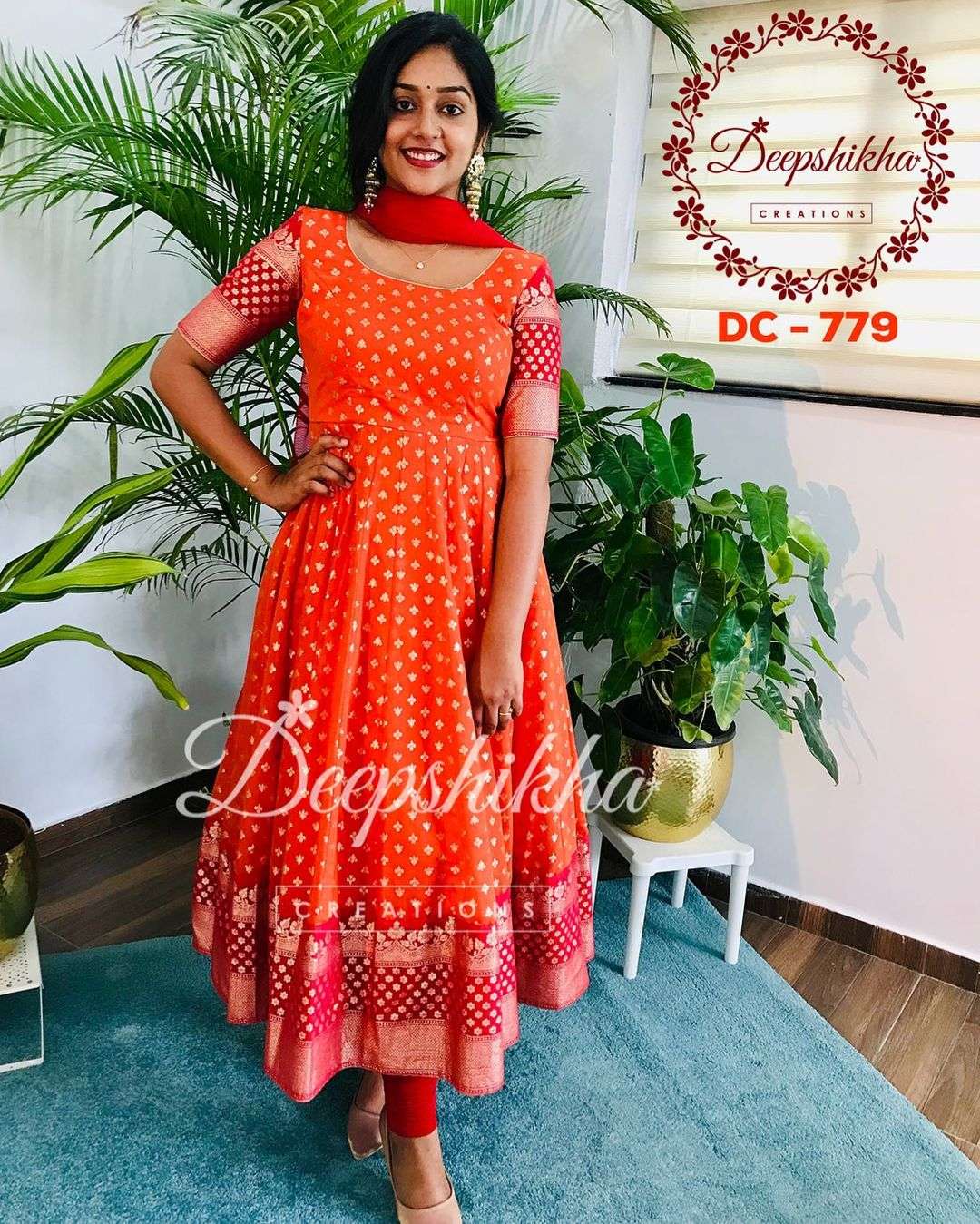 Stunning orange and red color combination pattu long frock with net dupatta. DC - 779. For queries kindly whatsapp: +91 9059683293. 2021-09-20