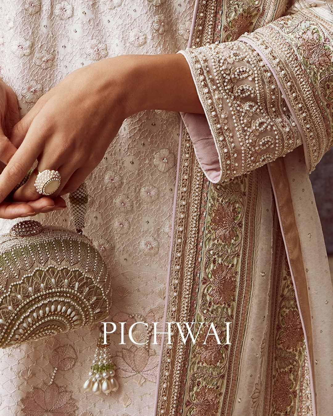 Sonali is wearing 18 kali ivory-beige and light-pink lehenga. Embellished with pichwai motifs the lehenga features hand embroidered pearls and resham detailing. Paired with a low-cut matching blouse and a satin organza dupatta. 2021-09-21