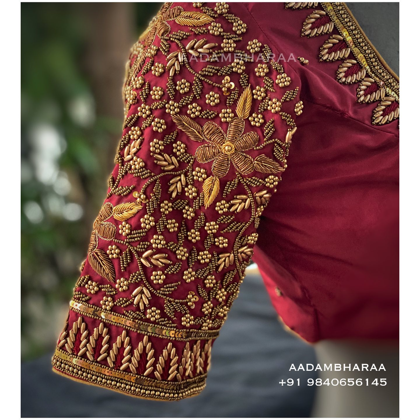 Gorgeous wine color bridal blouse sleeve with floral hand embroidery bead and gold thread maggam work.  2021-09-21