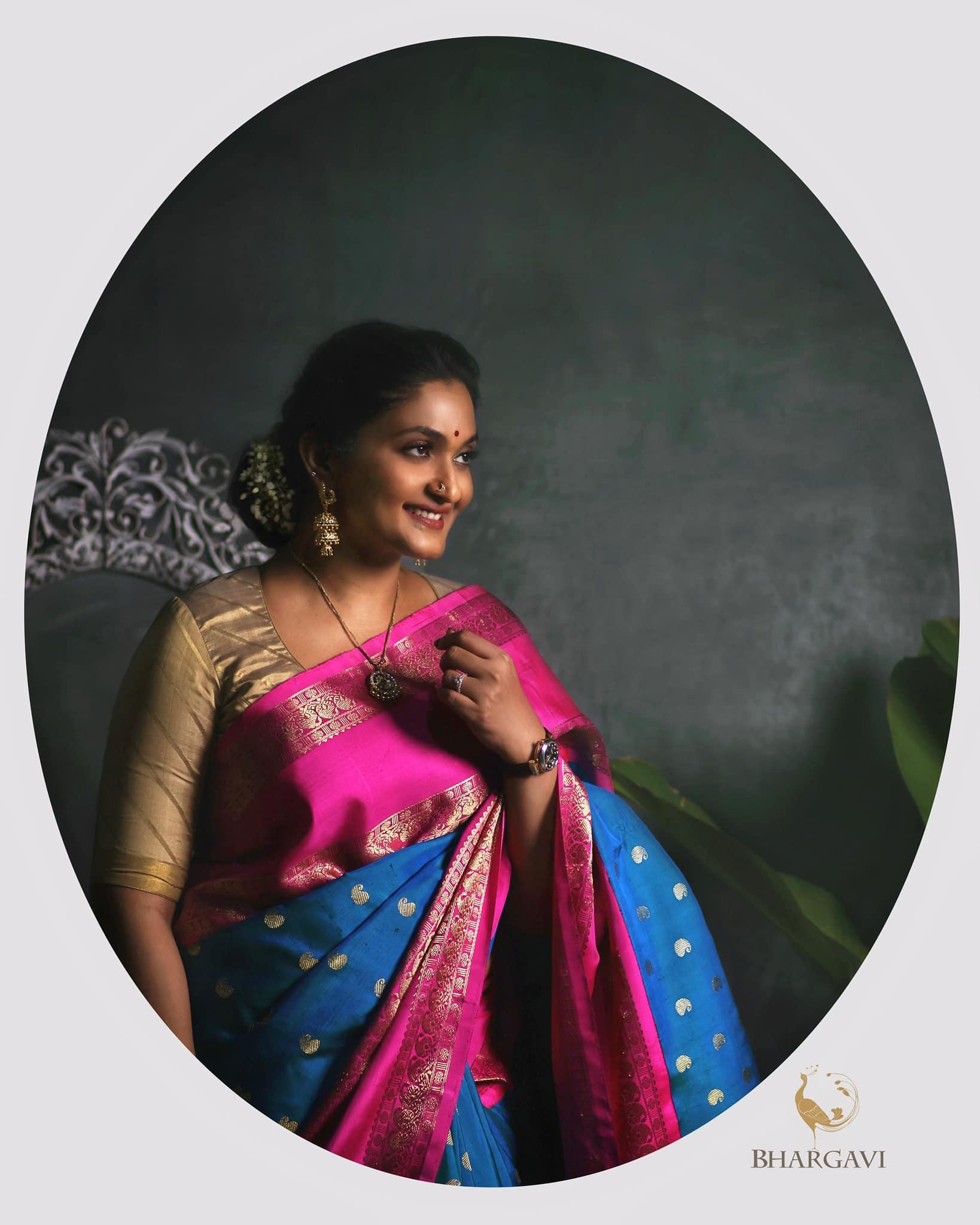 Beautiful designer Bhargavi Kunam in powder blue and pink color combination kanjeevaram saree.   2021-09-21
