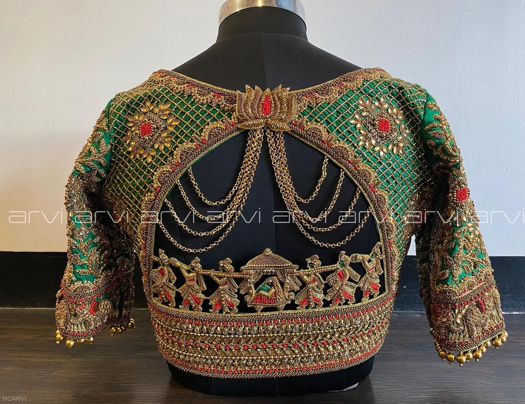 Gorgeous green color bridal blouse with bead and kundan doli or pallaki elephant hand embroidery aari work.  2021-09-21