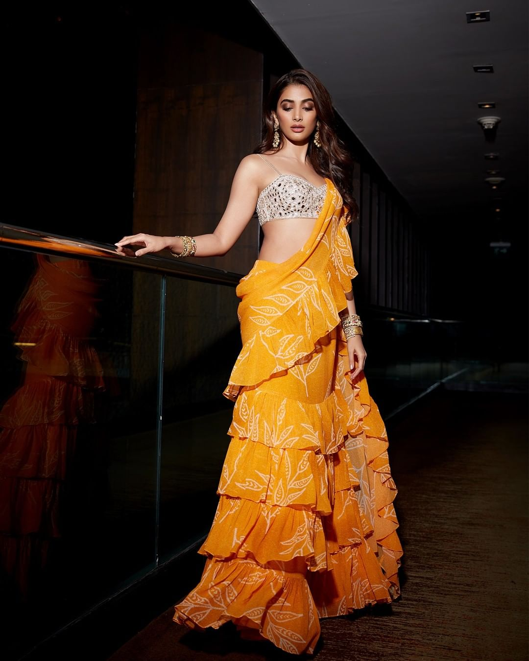 Turning heads in Poppy mango floral print ruffle sari set Pooja Hegde looks sensational at Siima Awards. 2021-09-21