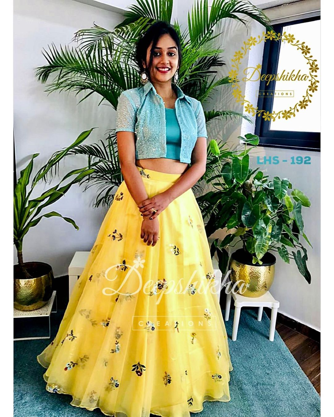 Beautiful yellow skirt and crop top with over coat. LHS - 192. For queries kindly whatsapp: +91 9059683293. 2021-09-21