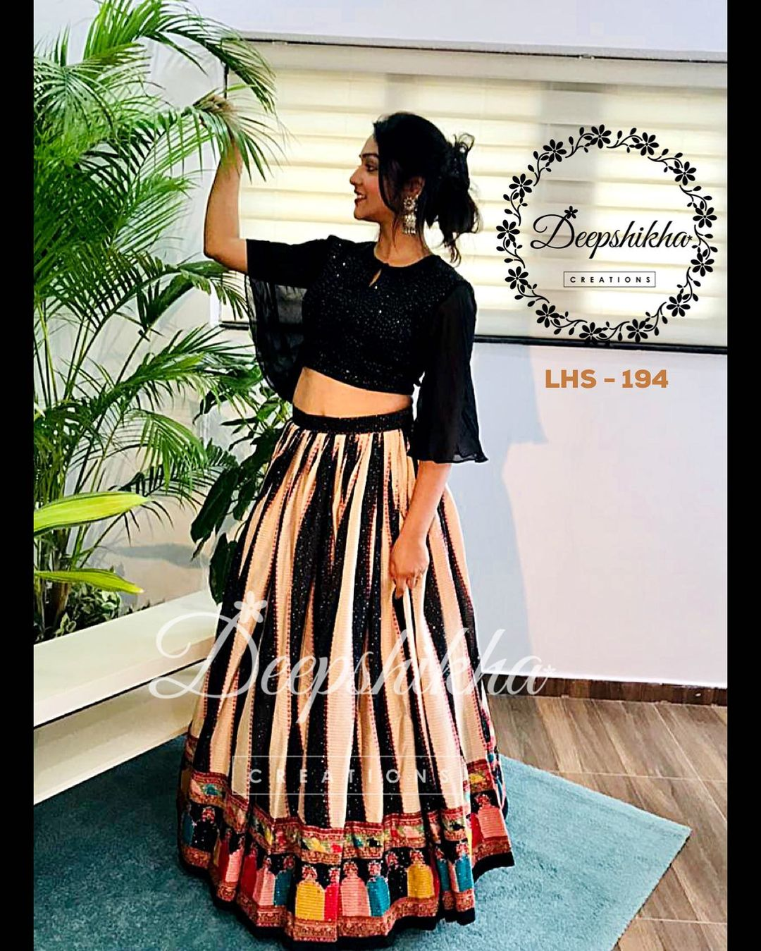 Beautiful multi color skirt and black bell sleeve crop top. LHS - 194. For queries kindly whatsapp: +91 9059683293. 2021-09-21
