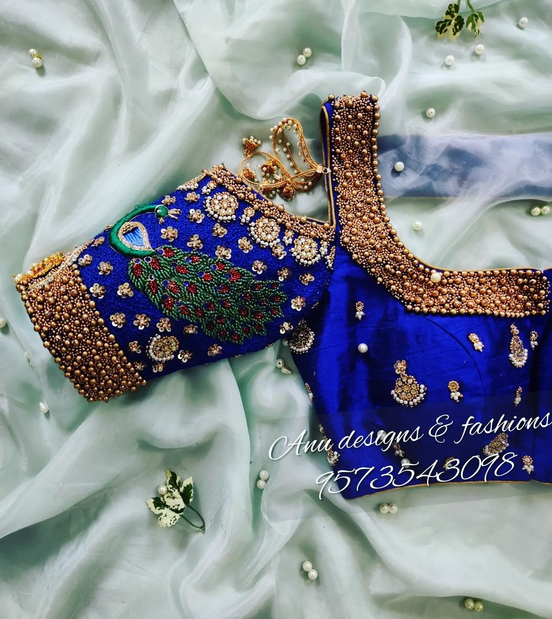 Stunning royal blue color cold shoulder bridal blouse with peacock hand embroidery maggam work.  2021-09-21