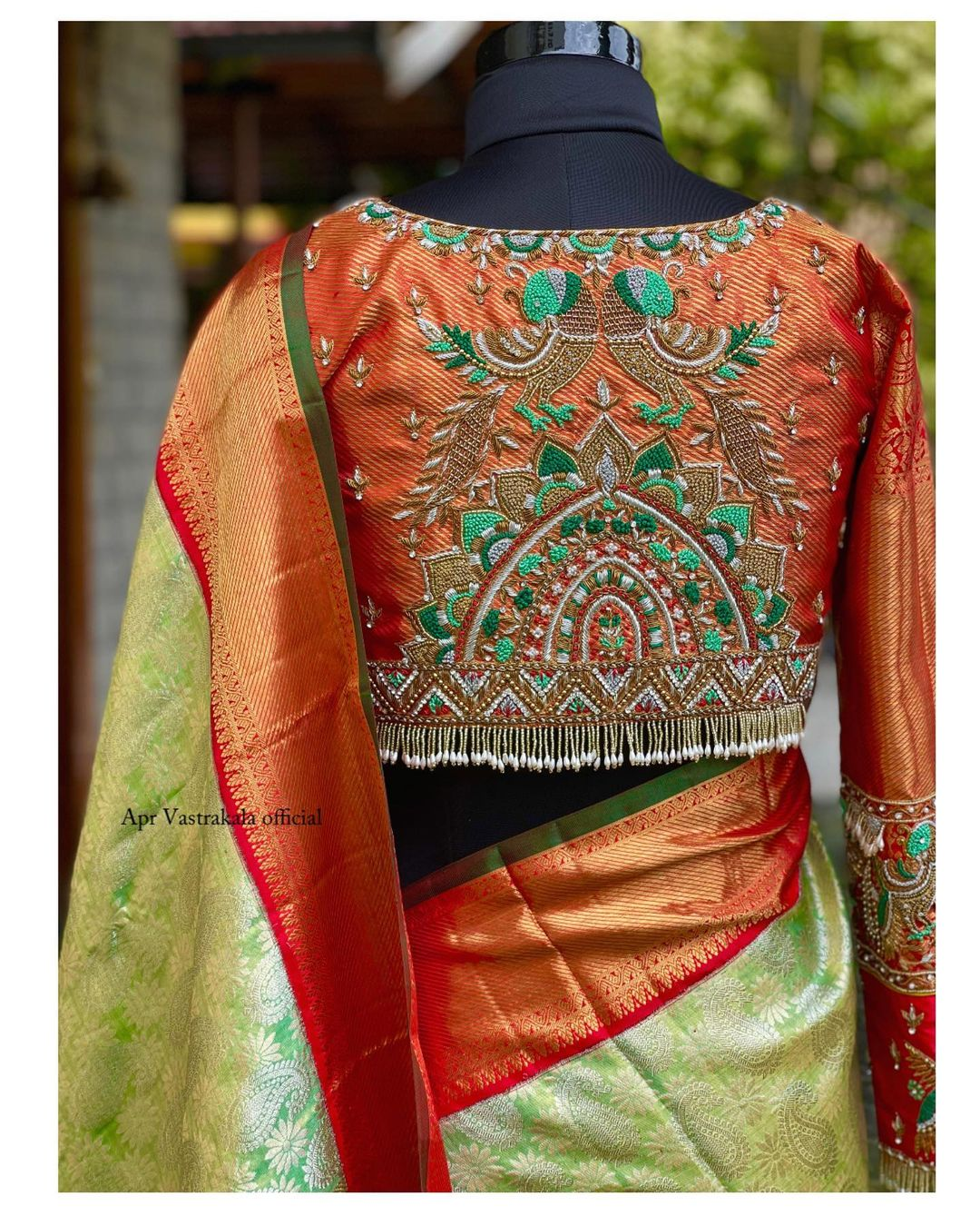 Beautiful bridal blouse with peacock hand embroidery thread maggam work. 2021-09-21