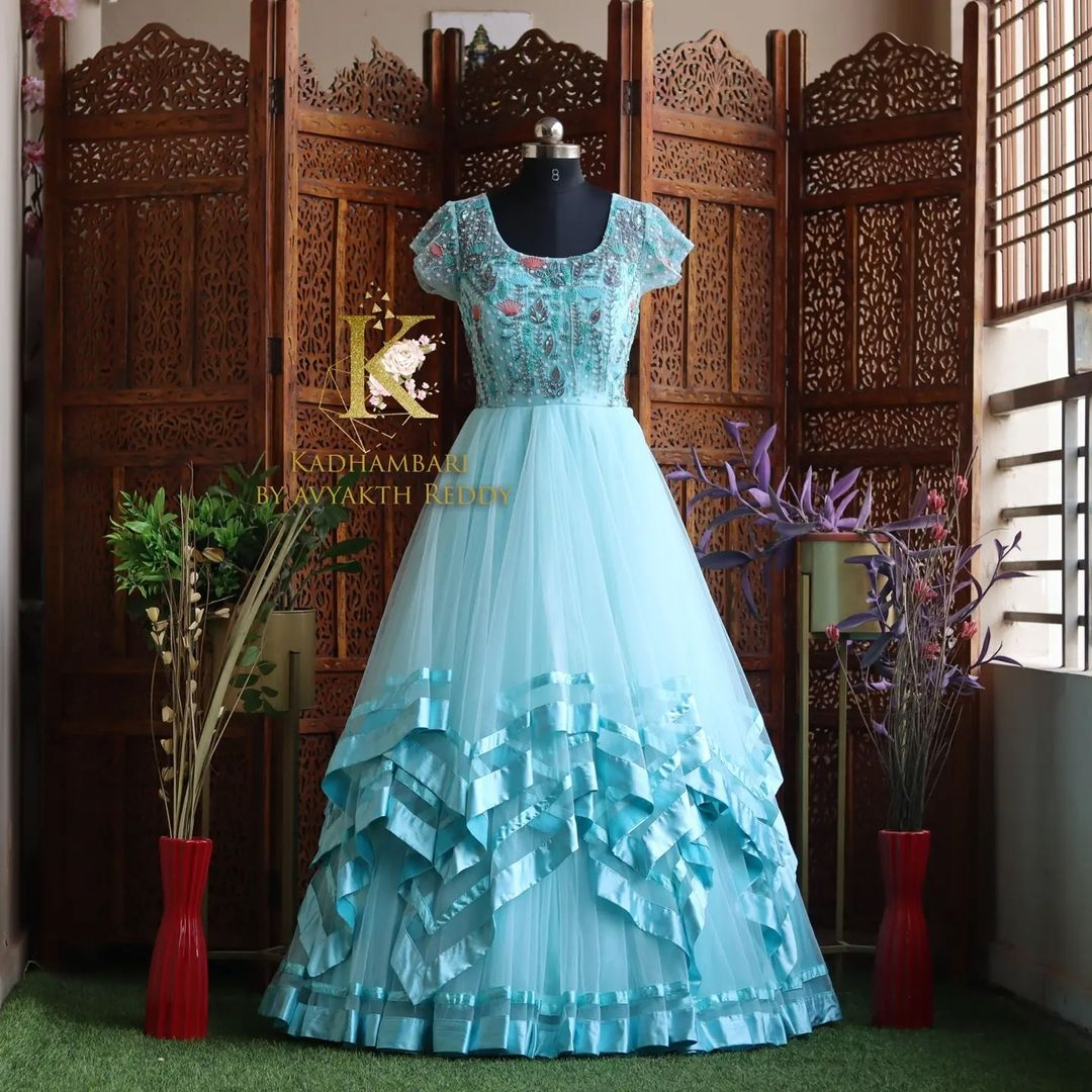 Stunning sea green color floor length layered long gown with floral hand embroidery work on yoke.  This outfit is Available@14800/- 2021-09-21