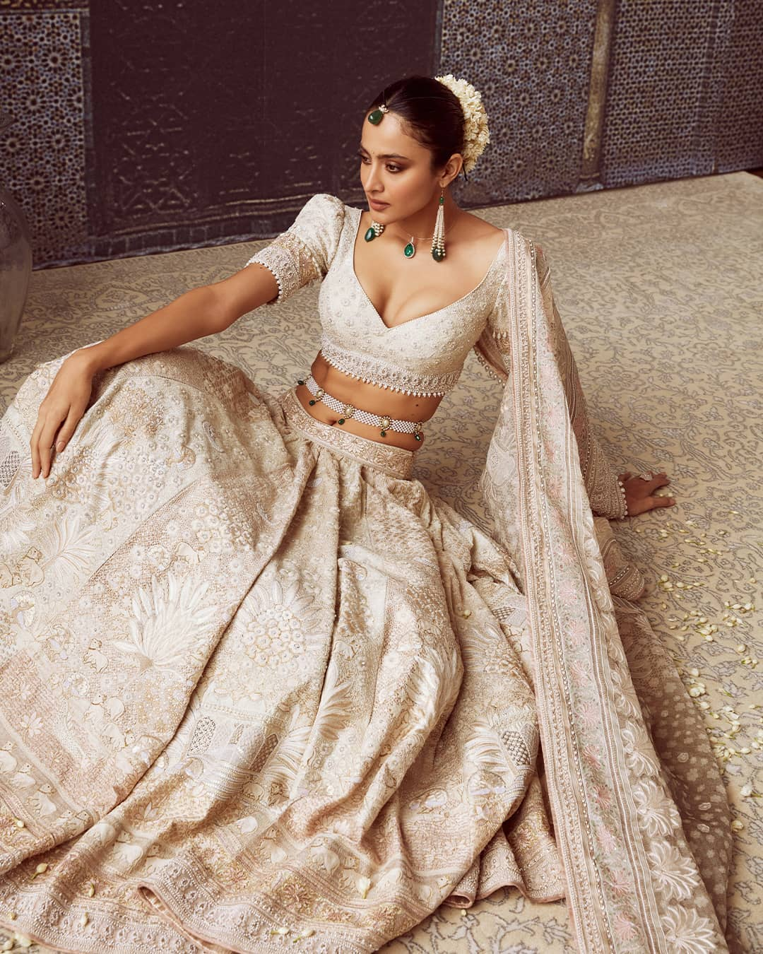Dressed in 18 kali ivory-beige and light-pink lehenga is Sonali. Paired with a low-cut matching blouse and a satin organza dupatta the lehenga is embroidered with pearls and resham detailing. 2021-09-22