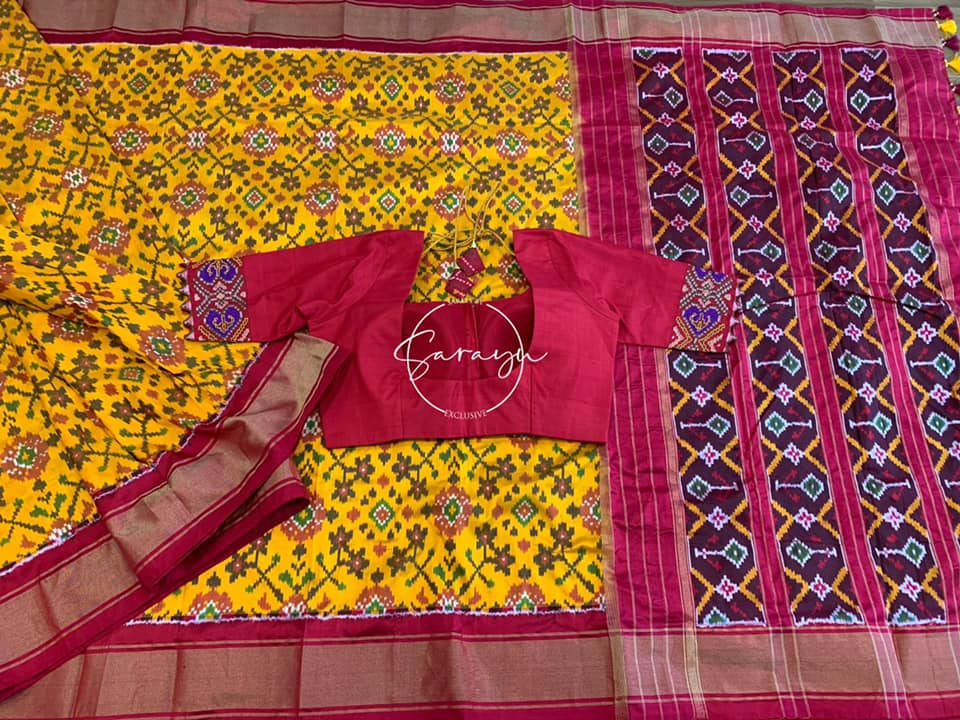Type: Ikkat Silk   Description:  Beautiful yellow and red very fine double Ikkat Silk Saree all over navarathna design weave with Patola Pallu complemented with contrast red hand worked  blouse 2021-09-22