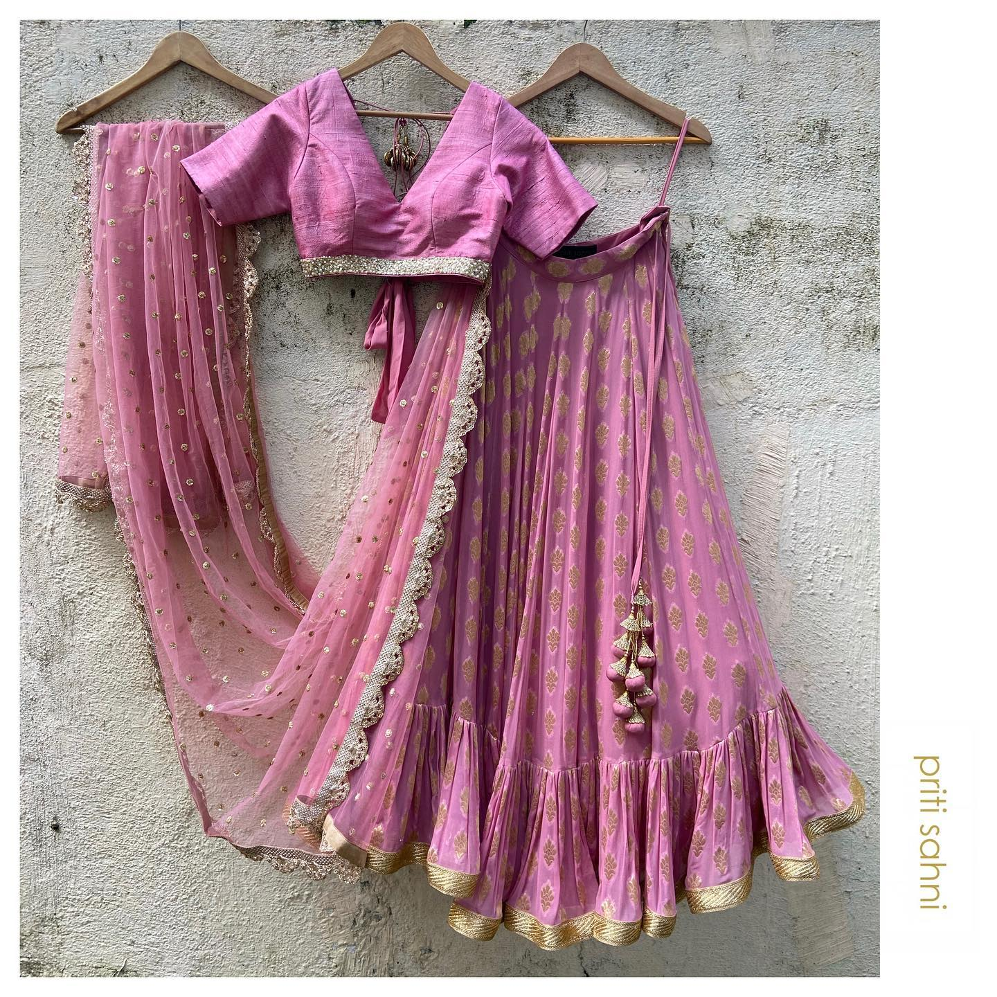 Rose Pink Love.  Rose pink lehenga with ruffle styling paired with rose pink raw silk blouse in sequin Pearl border and tie up detailing. The dupatta is in rose pink tulle with sequin work highlight all over  For more details DM or Whatsapp on +91-9022617481 2021-09-22