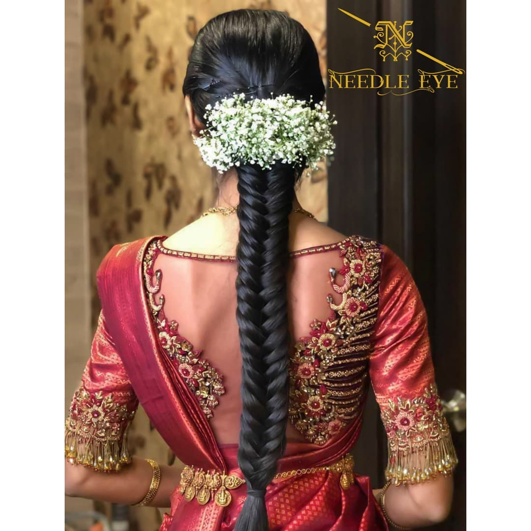 A simple hairstyle also can enhance your neck detail! Stunning sheer back bridal blouse with classy hand embroidery maggam work.  2021-09-22