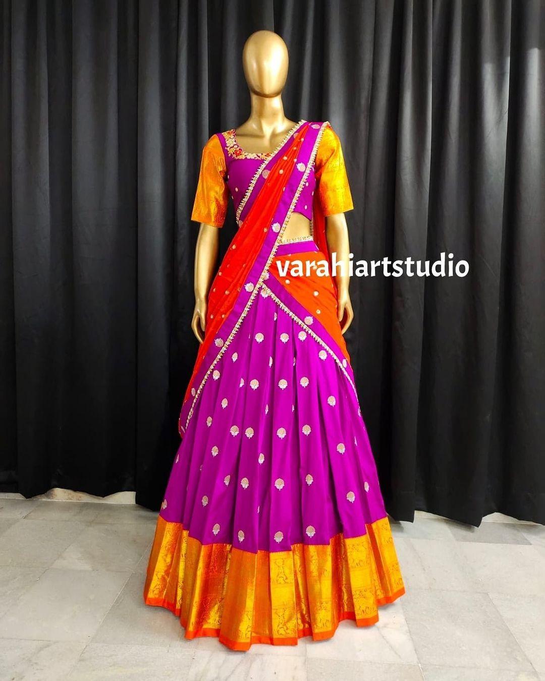 Gorgeous purple and orange color combination pattu halfsaree with net dupatta. 2021-09-22