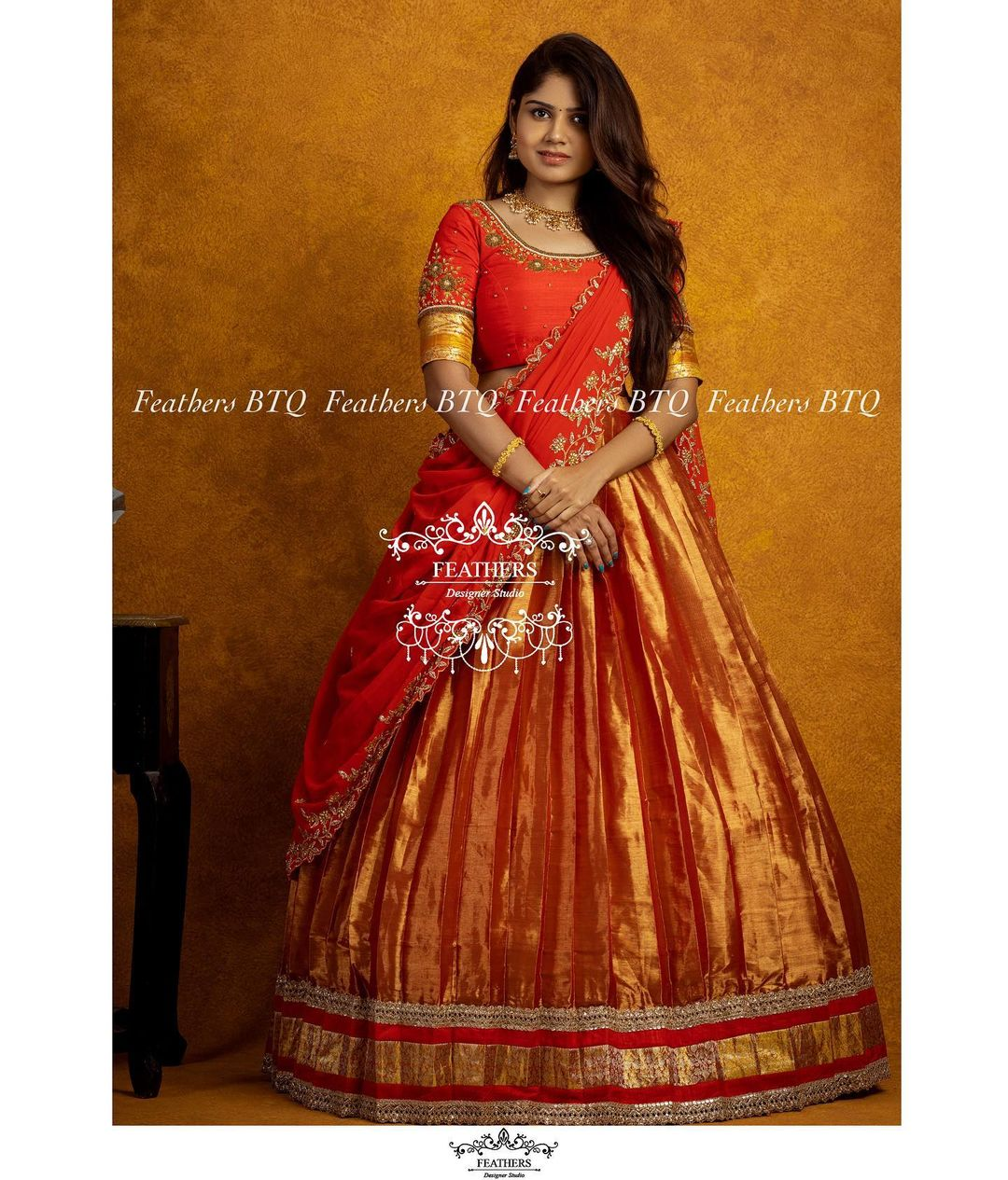 Stunning gold pattu lehenga and red blouse with net dupatta. Blouse with hand embroidery maggam work. Dupatta with cut work. 2021-09-22
